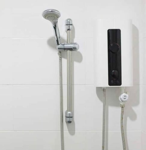white tankless water heater installed in shower with white tiled wall