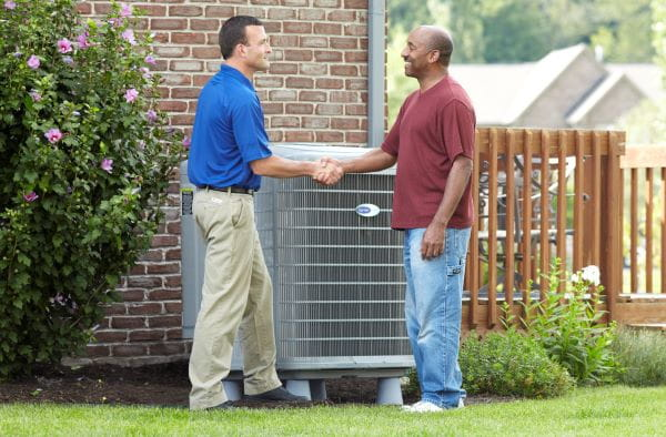 2 men talking about heating and air repair outside in humboldt tn