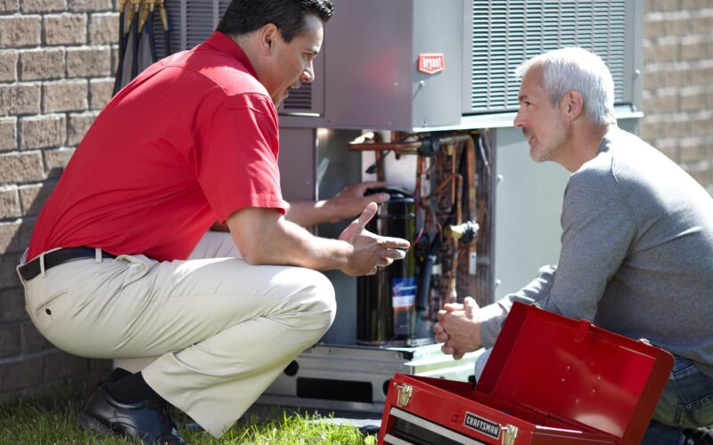 2 men talking over air conditioning services in jackson tn